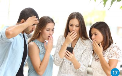 Group looking at phone with concern